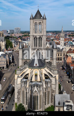 View from the top of the Belfrey towards St Nicholas Church and over the rooftops of the old buildings in Ghent city center. Ghent in Belgium. - Stock Image
