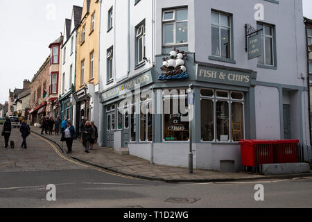A view of the historic High Street in Conwy, North Wales and the Galleon fish and chip restaurant - Stock Image