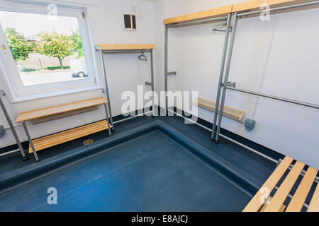Empty clothing drying room in army barracks. - Stock Image
