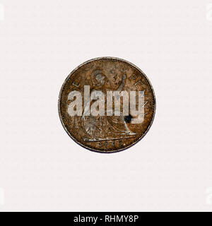 Example of pre decimal 1965  British 1 penny coin showing age and design of Britainnia - Stock Image