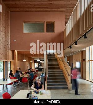 Entrance foyer with cafe area. The Enterprise Centre UEA, Norwich, United Kingdom. Architect: Architype Limited, 2015. - Stock Image