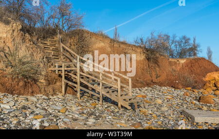 Old wooden stairs down to the sea near the village of Fontanka, Odessa region, Ukraine - Stock Image