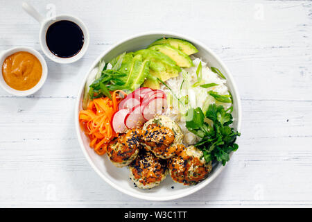 Turkey mince meat balls with pickled carrots, radishes, avocado and rice - Stock Image