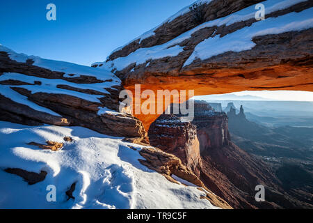 Mesa Arch under snow, Island in the Sky District, Canyonlands National Park, Utah USA - Stock Image
