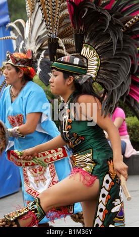Young Mexican Woman Dancing in an Aztec Costume, Zocalo Square, Plaza de la Constitucion, Mexico City, Mexico - Stock Image