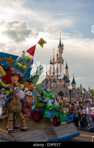 Toy Story parade passing the castle at Disneyland Paris - Stock Image