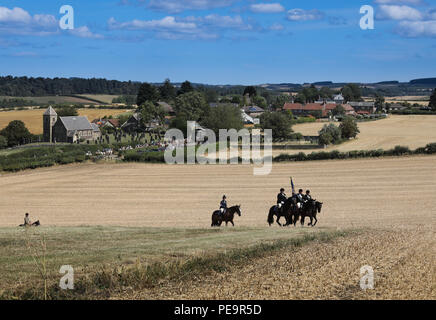 The Coldstreamer and his Right and Left Hand Man, Coldstream Civic Week ride over the Battlefield of Flodden during the annual Rideout - Stock Image
