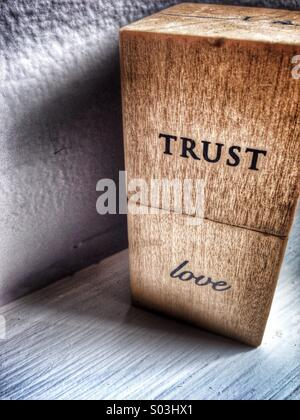 Trust love written on blocks. - Stock Image