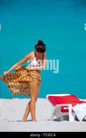 Miami Beach Florida South Beach Atlantic Shore woman in bikini wrapping self with beach towel - Stock Image
