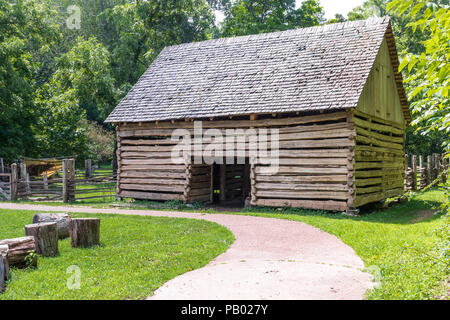 GOLDEN POND, KY, USA-30 JUNE 18:  A barn at The Homeplace, an 1850s working farm and living history museum, located on The Trace road. - Stock Image
