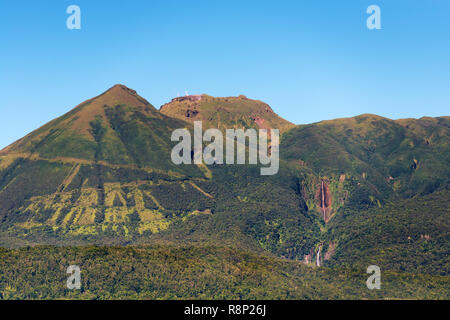 Guadeloupe, french west indies.Rare view of the 'soufriere' volcano, no clouds,fumaroles at the top and visible waterfalls 'carbet'. - Stock Image