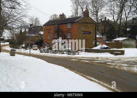 Pear Tree Inn after a March snowfall, Hook Norton, Oxfordshire - Stock Image