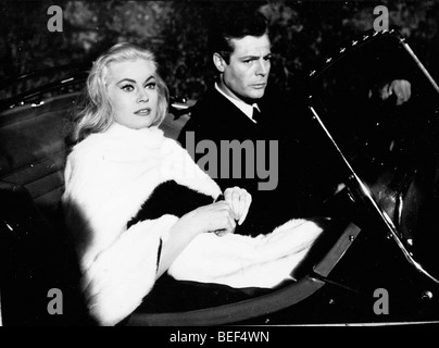 Anita Ekberg and Marcello Mastroianni in a scene from Fellini's 1960 film, 'La Dolce Vita.' - Stock Image