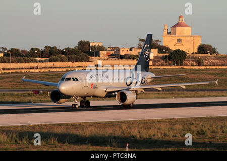 CSA Czech Airlines Airbus A319 airliner in Skyteam colours on the runway during takeoff from Malta at sunset. Air travel in the EU. - Stock Image