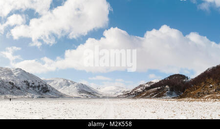 A view of the upper Findhorn valley below the snow-covered Monadhliath Mountains in Inverness-shire, Scotland. March. - Stock Image