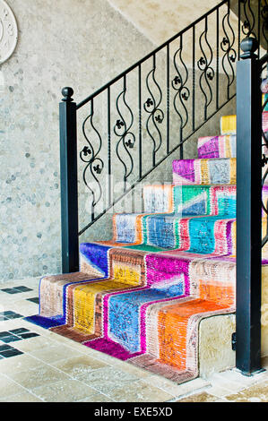 Stairs covered by a colorful carpet - Stock Image