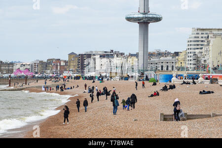 Brighton UK 6th May 2019 - Visitors wrap up warm on Brighton beach as they enjoy the May Bank Holiday with unsettled cool conditions forecast to continue throughout Britain over the next few days. Credit: Simon Dack / Alamy Live News - Stock Image