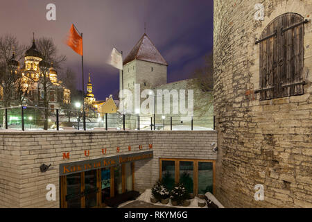 Winter night at Tallinn city walls with Alexander Nevsky orthodox church in the distance. - Stock Image