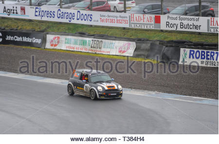 Dunfermline, Scotland, UK. 7th April, 2019.  Race  winner Oliver Mortimer acknowledges the crowds applause after a Scottish Fiesta/Mini Cooper S Cup  race at Knockhill Circuit. During a wet and misty opening round of the Scottish Championship Car Racing season organised by the SMRC (Scottish Motor Racing Club) at Knockhill. Credit: Roger Gaisford/Alamy Live News - Stock Image