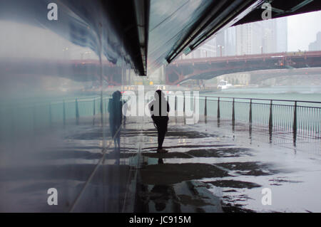 Chicago, United States. 14th Jun,  2017. A lone womans weight under the bridge beside Chicago River under Wabash - Stock Image