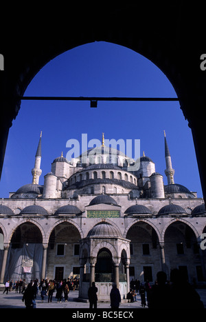 View through archway into the internal courtyard of Sultanahmet Camii (the Blue Mosque) - Stock Image