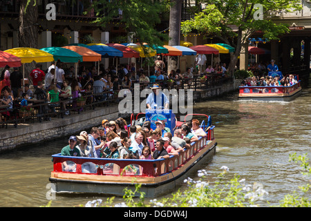 Tourists taking a boat ride along the San Antonio Riverwalk Texas USA - Stock Image