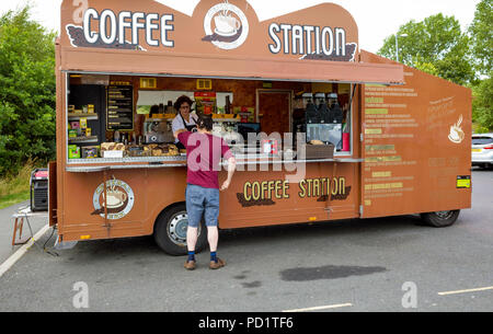 A man buying refreshments from a mobile Coffee Station stall in the car park for the Angel of the North Gateshead - Stock Image