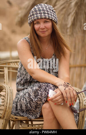 Lady in Bedouin Style Scarf. Dahab. South Sinai. Egypt - Stock Image