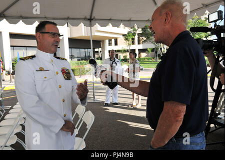 180831-N-IE405-011 SAN DIEGO (Aug. 31, 2018)-- Rob Lenderman, a reporter from KUSI, interviews Capt. Joel Roos during Roos' change of command and retirement ceremony as the outgoing commanding officer of Naval Medical Center San Diego. Naval Medical Center San Diego is the largest Naval medical facility on the West Coast, providing service to active duty, reservists, retirees, and their dependents.  (U.S. Navy photo by Mass Communication Specialist 2nd Class Indra Beaufort/RELEASED) - Stock Image