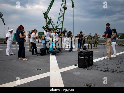 180828-N-RG482-169    VARNA, Bulgaria (Aug. 28, 2018) Civil service mariner Jonathan Keffer, second from right, civilian master of the Spearhead-class expeditionary fast transport ship USNS Carson City (T-EPF 7), speaks during a press event with Bulgarian media in Varna, Bulgaria, Aug. 28, 2018. Carson City is the seventh of nine expeditionary fast transport ships in Military Sealift Command's inventory with a primary mission of providing rapid transport of military equipment and personnel in theater via its 20,000 square foot reconfigurable mission bay area and seating for 312 passengers. (U. - Stock Image