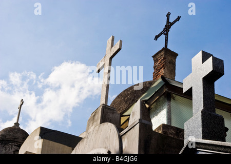 Crucifixes on top of a row of tombs in Recoleta Cemetary - Stock Image
