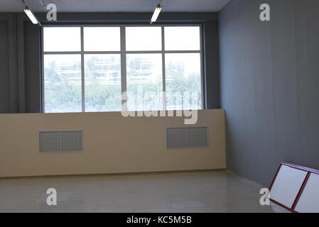 Shop interior in an empty state with no furniture or people - Stock Image