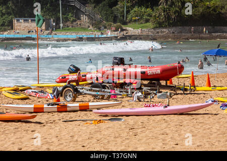 Surf rescue surfboards and red zodiac surf rescue boat on Palm beach in Sydney,Australia - Stock Image