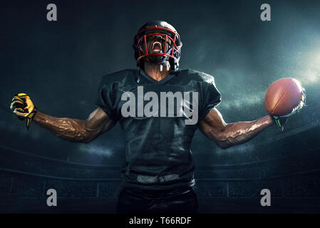 Muscular football player cheering - Stock Image