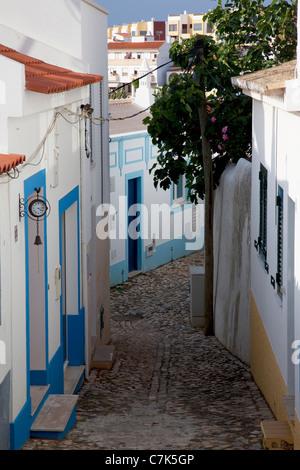 Portugal, Algarve, Ferragudo, Colourful Backstreet - Stock Image