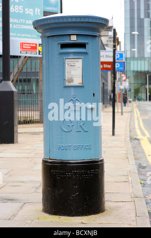 old air mail pillar box letterbox postbox light blue manchester - Stock Image