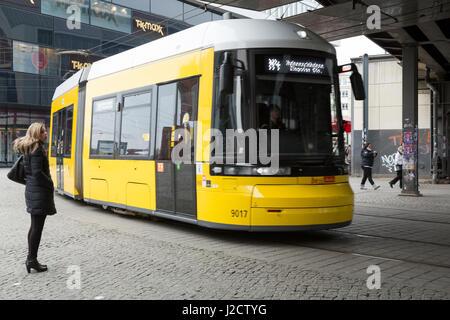 Germany, Berlin. Bright yellow streetcar at Alexanderplatz. Credit as: Wendy Kaveney / Jaynes Gallery / DanitaDelimont.com - Stock Image