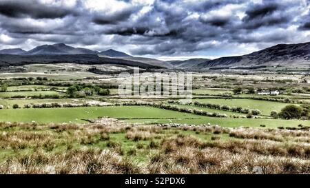 Dramatic picture of dark clouds over the mountains on the Isle of Arran, Scotland. (Filter added) - Stock Image