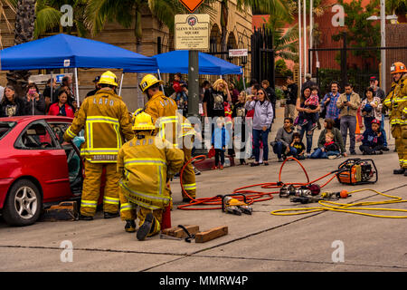 Los Angeles, California, USA 12 May 2018 A Los Angeles City Firefighters from Truck 27 in Hollywood doing a demo of a resuce using a rescue tool on Fire Service Day. Credit: Chester Brown/Alamy Live News - Stock Image