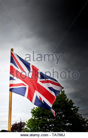 British Union Jack  flag in village in the Cotswolds in Oxfordshire with Britain approaching Brexit. - Stock Image