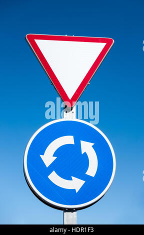 Roundabout and give way sign in Spain - Stock Image