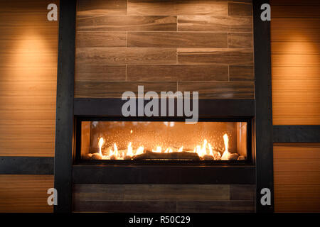 Modern gas fireplace in wall of Amsterdam Brewhouse restaurant at Toronto Harbourfront - Stock Image