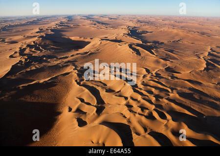 Aerial view over sand dunes, Namib Desert, Namibia - Stock Image