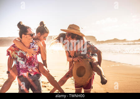 Cheerful people in sunny summer holiday vacation day - outdoor leisure activity with couples laughing a lot and have fun together in friendship - frie - Stock Image