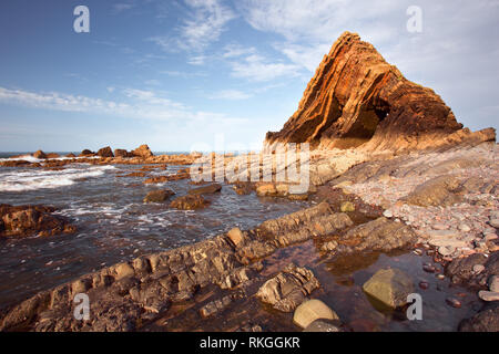 A summers day at Blackchurch Rock Mouthmill cove Devon uk - Stock Image