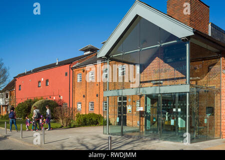 Young mothers and their children outside the Farnham Maltings, the museum, arts, theatre and community centre in a converted brewery in Farnham, Surre - Stock Image