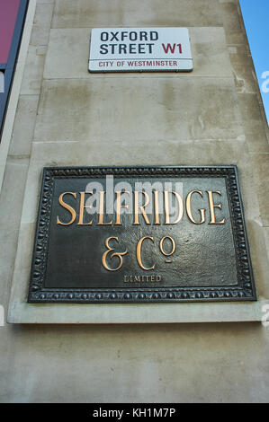 Selfridge store sign on Oxford Street in London's West End - Stock Image