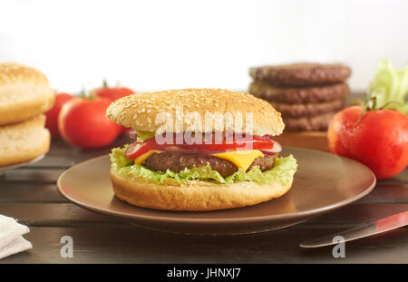 Cheeseburger and its ingredients - Stock Image