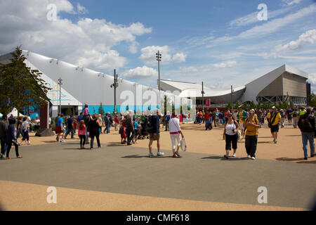 Water Polo Arena and Aquatics Centre with people on a sunny day at Olympic Park, London 2012 Olympic Games site, - Stock Image