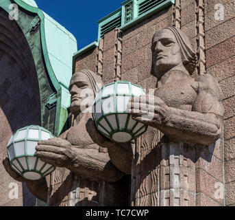 Stone Men Statues at Helsinki Central Railroad Station - Stock Image